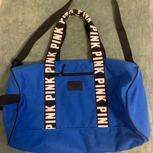 Gently used (pink) blue duffle bag
